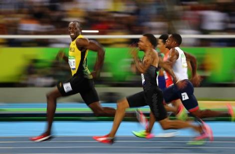 Foto do alemão Kai Oliver Pfaffenbach, que congelou o sorriso vitorioso do atleta jamaicano Usain Bolt nas Olimpíadas do Rio